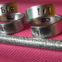 big sis lil sis ringsthe original  set of two aluminum swirl version  style  rings 1/4 inch