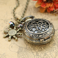 Vintage star pocket watch necklace with antique bronze sun charm and crystal charm by luckyvicky