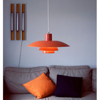Orange Danish designer Poul Henningsen PH 4/3 pendant 1966. Gradient lighting.