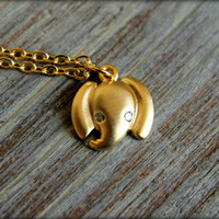 Tiny Elephant Head Necklace in Matte Gold