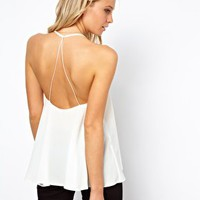 ASOS PETITE Cami With Backless Detail And Plunge Neck at asos.com