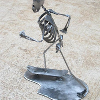 Zombie Skeleton Skateboarding Metal Sculpture by zedszombieranch