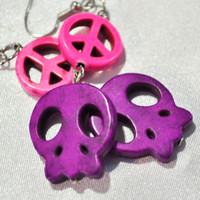 Purple skull with pink peace sign earrings from  howlite