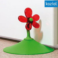 Koziol April Doorstop ? red & green funky door stop flower