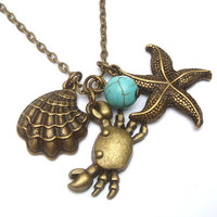 Antiqued Brass Starfish Shell Crab Turquoise Necklace by gemandmetal