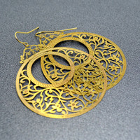 Big round laser cut gold tone filigree earrings by thestudio8