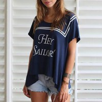 "Navy Short Sleeve Asymmetric Top with ""Hey Sailor"" Print"