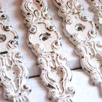 French style Chippy Paint Vintage brass escutcheons painted and distressed, drawer hardware in antique white