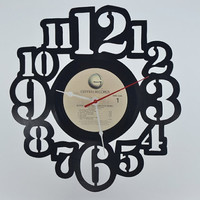 Wall Clock Handmade from a vinyl record album (artist is Elton John)