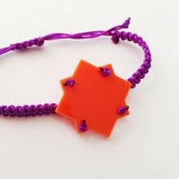 Friendship bracelet macrame in tangerine and purple
