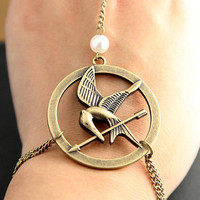 The Hunger Games pendant Mockingjay Arrow and Peeta by qizhouhuang