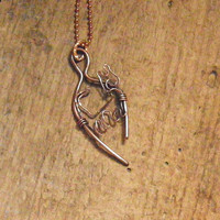 A girl and her dog necklace in hand forged by WillowRockDesigns
