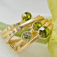 Peridot Stacking Rings Clear Crystal Accents and Matte Gold Plating - Set of Five | LightMetals - Jewelry on ArtFire