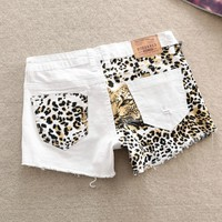A 073001 zz Stitching Slim hip sexy leopard small hole shorts