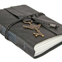 Black Leather Journal with Winged Clock Key Charm by boundbyhand