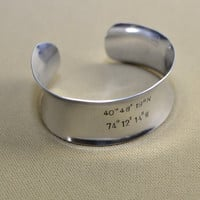 Sterling silver anticlastic latitude longitude cuff bracelet with personalized coordinates