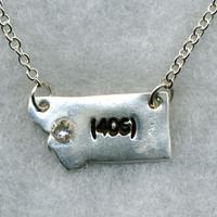 "State of Montana - silver (406) pendant on a silver-plated chain.  18"" with Lobster claw clasp."