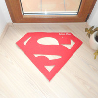 Rug made with a Superman logo. Sign doormat. Custom door mat shape.