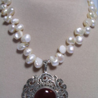 White Pearl necklace with a Carnelian in a shiny Marcasite setting pendant  in a for-ever-fashionable design