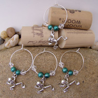 wine glass charms. set of 4. on each is a stainless steel frog