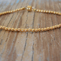 Tiny Gold Beaded Friendship Bracelet by minniegrace on Etsy