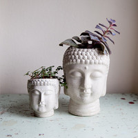 Two Buddha Head Planters - small and large