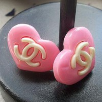 Huge heart Logo pink and white earrings by NotenApparel on Sense of Fashion