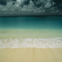 Wave Rolls over a Tranquil Beach in the Marshall Islands Photographic Print by Bill Curtsinger at Art.com