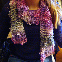 This scarf is made of acrylic yarn with delicate petals throughout.
