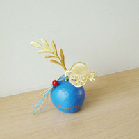Small pomerganate sculpture on blue base, brass pomegranate and leaf on a blue colouredstone, Greek folk art, good luck pomegranate
