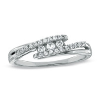 1/6 CT. T.W. Diamond Three Stone Swirl Bypass Ring in 10K White Gold