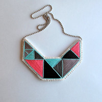 Embroidered bib necklace in beautiful colors of hot pink mint green black and grays geometric design