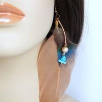 Peach freshwater pearl and blue howilite earrings with feathers.