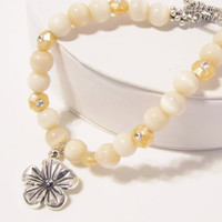Ivory Cats Eye Bracelet with Flower Charm