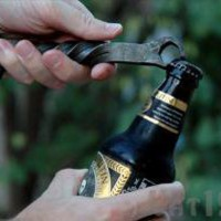 Railroad Spike Bottle Opener: Hand-forged from reclaimed railroad spikes
