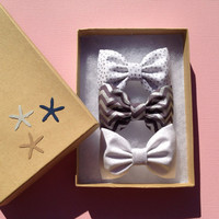 Silver shimmer, silver dot and silver chevron bows for the holidays. Christmas gift from Seaside Sparrow bows.