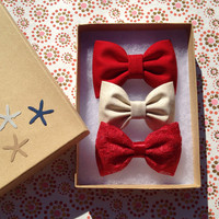 True red, gold shimmer, and red lace holiday hair bows. Seaside Sparrow bows make the perfect Christmas gift.