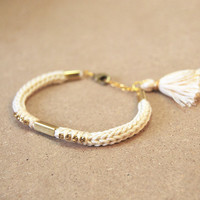 Beige bracelet with rhinestones, knit bracelet with tassel charm, tube bracelet, friendship bracelet