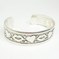 Silver-tone cuff bracelet with hearts and lips