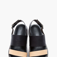 TAN AND BLACK LEATHER FUSBETT SANDALS