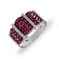 Round cut ruby and diamond ring