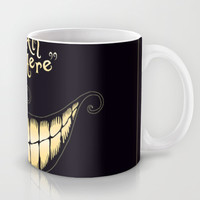 We're All Mad Here Mug by Greckler
