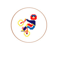 Modern Cross Stitch pattern of mountain biker. Fancy sports man gift in fresh colors for a boy. English, Spanish and Dutch pattern