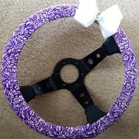 Purple and white fabric steering wheel cover with bow