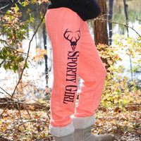 sporty girl deer skull fleece neon orange sweatpants