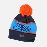 NIKE WOVEN SCRIPT POM BEANIE (ARMORY NAVY/GAMMA BLUE-SAFETY ORANGE)