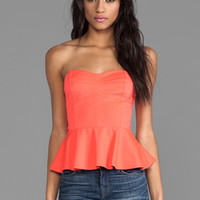 Amanda Uprichard Strapless Peplum Top in Neon Orange
