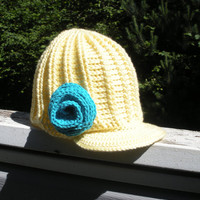 Chunky ribbed crochet newsboy hat in Lemon Meringue with large turquoise spiral rose, ready to ship